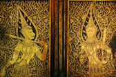 Golden antique drawing of Thai guarden angels on temple door — Stock Photo
