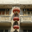 Chinese lanterns hanged on old building — Stock Photo