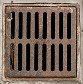 Manhole cover metal storm drain — Stock Photo