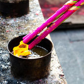 People burning incense upon the incense — Stockfoto