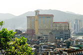 MACAU - MARCH: A city view on March 26, 2014 in Macau. Macau is the most densely populated region in the world, with a population density of 18,428 persons per square kilometer. — Stock Photo