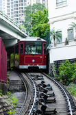 HONGKONG - MARCH 27. Peak Tram, March 27, 2014, Hongkong, Japan. Peak Tram is one of the symbol of Hongkong left from the British times. It is one of the most famous sight draws tourists daily. — Foto Stock