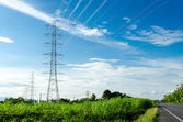 High voltage post with the sun — Stock Photo
