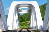 Old white railway bridge constructed against a blue sky in Lamphun, Thailand. — Stock Photo