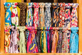 The scarf shop at the market — Stock Photo