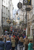 A lot of people visit the popular street of Salzburg — Stock Photo