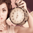 Young woman holding big clock — Stock Photo