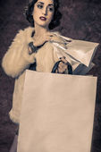 Vintage picture of young woman holding shopping bags — Stock Photo