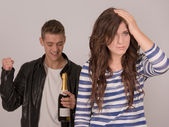 Young man partying and young woman worrying — Stock Photo