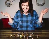 Smiling young woman in front of many rings — Stock Photo