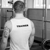 Trainer in fitnesscenter standing facing away — Stock Photo