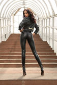 Sexy female wear leather suit — Stock Photo