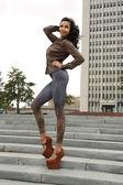 Brunette in leopard leggings on street — Stok fotoğraf