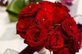 Red roses and pearls bouquet — Stock Photo