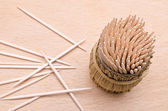 Wooden toothpicks from above on a cutboard — Stock Photo