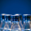 Bottled water on a blue background — Stock Photo