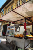 Street vendor selling fried snacks — Stock Photo