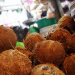 Coconuts at a local market stall — Stock Photo