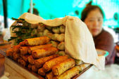 Pile of fresh and fried spring rolls, local food — Stock Photo