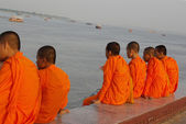 Buddhist monks in Cambodia at a riverfront — Stock Photo