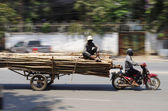 Oversized timber transport by motorbike — Stock Photo