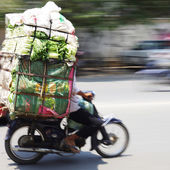 Big load of fresh greens, oversized transport by motorbike — Stock Photo