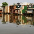 Stock Photo: Tin shacks along river, almost collapsing