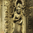 Apsara dancer bas-relief on ancient Angkor temple — Stock Photo #37565629