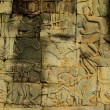 Apsara dancer bas-relief on ancient Angkor temple — Stock Photo #37567597