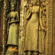 Apsara dancer bas-relief on ancient Angkor temple — Stock Photo #37567967