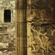 Apsara dancer bas-relief on ancient Angkor temple — Stock Photo #37568229