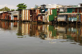 Tin shacks along a river, almost collapsing — Stock Photo