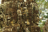Carved stone faces at ancient temple in Angkor Wat, Cambodia — Stock Photo