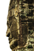 Carved stone faces at ancient temple in Angkor Wat, Cambodia — Stock fotografie