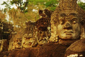 Carved stone heads at ancient temple in Angkor Wat, Cambodia — Stock Photo