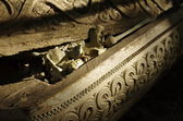 Bones in an old carved wooden coffin — Stock Photo