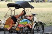 Rickshaw driver taking a nap — Stock Photo
