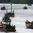 Stock Photo: Many fishing boats heading out to sea