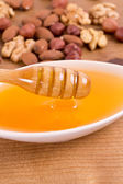 Honey and oil seeds — Stock Photo