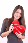 "Young smiling girl with ""I love you"" pillow in her hand — Stock Photo"