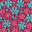 Seamless flower design pattern in vector — Stockvectorbeeld