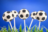Soccer ball cake pops — Stock Photo