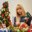 Girl unhappy with a wrong christmas gift — Stock Photo