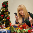 Girl unhappy with an undesirable christmas gift — Stock Photo #37266449