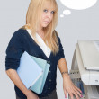 Stock Photo: Distracted office girl with thought bubbles near photocopier