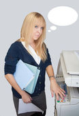 Distracted office girl with thought bubbles near photocopier — Stock Photo