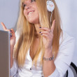 Smiling happy girl enjoys music with headphones — Stock Photo