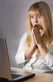 Girl worried in front of computer — Stock Photo