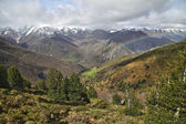 Rainbow over mountains in early spring, Asturias. Spain. — Stock Photo