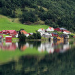 Reflection of a small town in a norwegian fiord, Norway. — Stock Photo